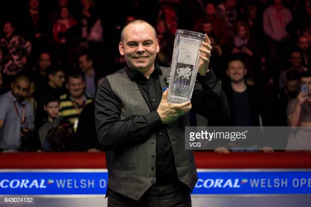 Stuart Bingham of England celebrates with his trophy after winning the final match against Judd Trump of England on day seven of 2017 Coral Welsh...