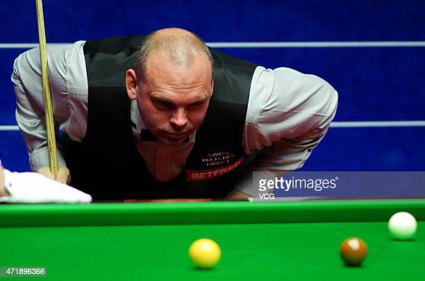 Stuart Bingham of England eyes the ball against Judd Trump of England during semifinal match on day fourteen of the 2015 Betfred World Snooker...