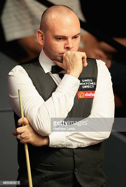 Stuart Bingham of England looks on during his match against Ken Doherty of Ireland during day one of the The Dafabet World Snooker Championship at...