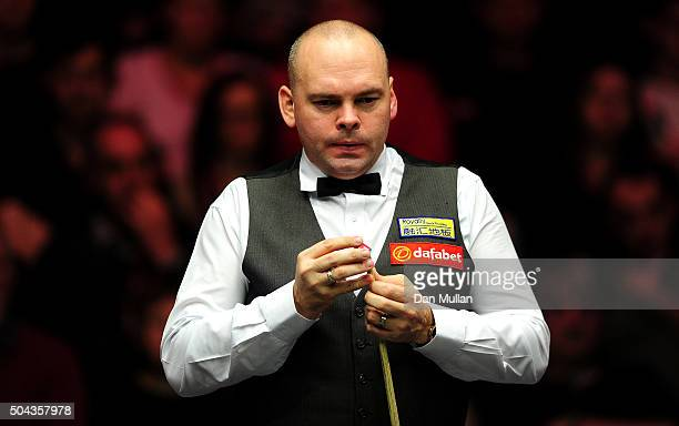Stuart Bingham of England looks on whilst playing against Ding Junhui of China during Day One of the Dafabet Masters at Alexandra Palace on January...