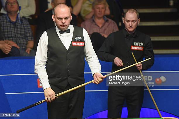 Stuart Bingham of England looks on with Graeme Dott of Scotland during day seven of the 2015 Betfred World Snooker Championship at Crucible Theatre...