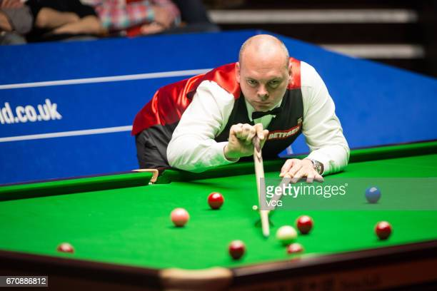 Stuart Bingham of England plays a shot during his second round match against Kyren Wilson of England on day six of Betfred World Championship 2017 at...