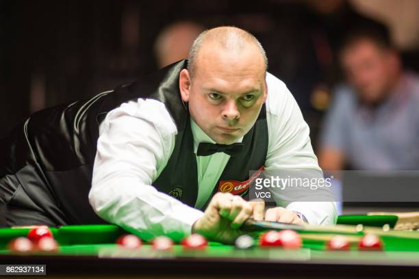 Stuart Bingham of England plays a shot during his second round match against Fang Xiongman of China on day three of 2017 Dafabet English Open at...