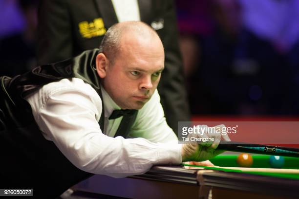 Stuart Bingham of England plays a shot during his third round match against Matthew Stevens of Wales on day four of 2018 ManBetX Welsh Open at...