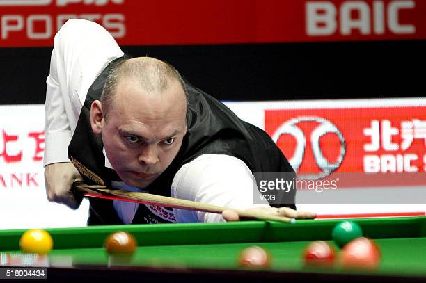 Stuart Bingham of England plays a shot during the first round match against Sam Baird of England on day two of China Open at Beijing University...