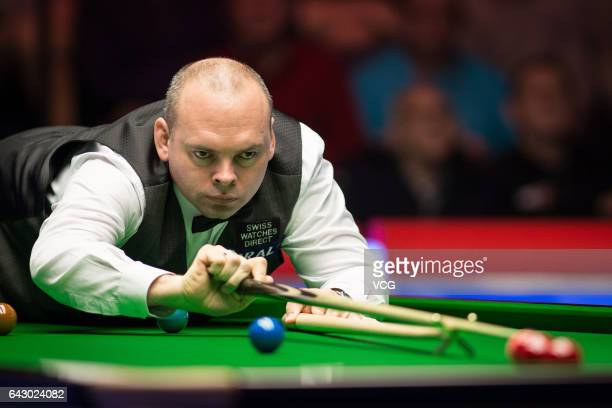 Stuart Bingham of England plays a shot in the final match against Judd Trump of England on day seven of 2017 Coral Welsh Open at the Motorpoint Arena...