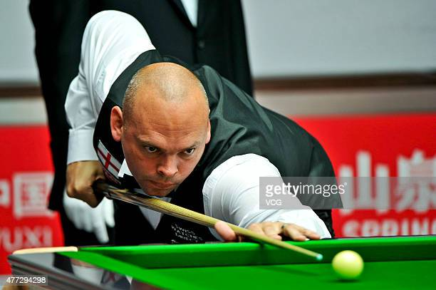 Stuart Bingham of England plays a shot in the match against Thailand on day one of Snooker World Cup 2015 at Wuxi Stadium on June 15 2015 in Wuxi...