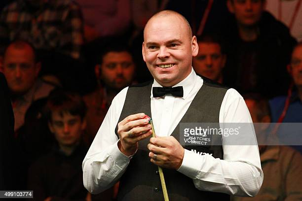 Stuart Bingham of England reacts during a match against Anthony Hamilton of England in their second round matches on day four of Betway UK...