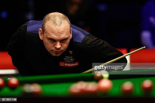 Stuart Bingham of England reacts during the quarterfinal match against Ding Junhui of China on day two of Champion of Champions 2016 at Ricoh Arena...
