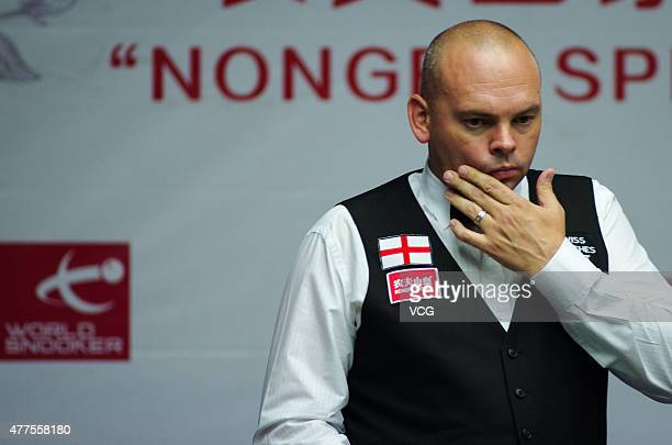 Stuart Bingham of England reacts in Doubles match with Mark Selby of England against Khalid Alkamali and Mohammed Shehab of United Arab Emirates on...
