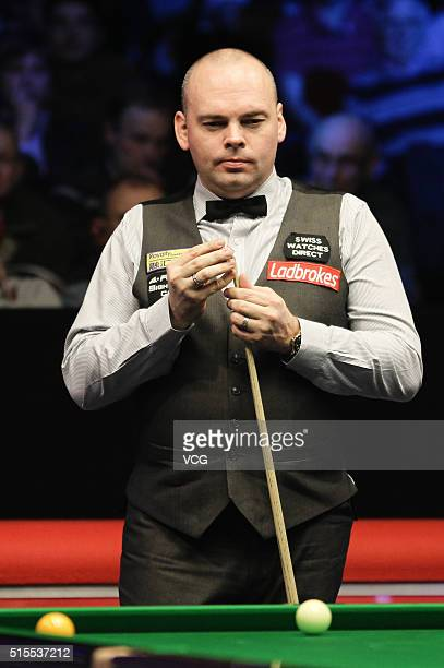 Stuart Bingham of England reacts in the final match against Shaun Murphy of England on day six of the Ladbrokes World Grand Prix at Venue Cymru on...