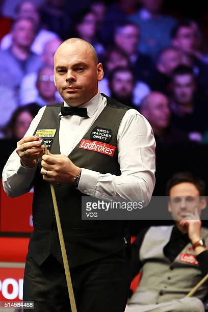 Stuart Bingham of England reacts in the first round match against David Gilbert of England during the Ladbrokes World Grand Prix at Venue Cymru on...