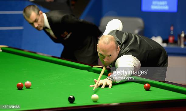 Stuart Bingham plays a shot against Shaun Murphy during the final of the 2015 Betfred World Snooker Championship at Crucible Theatre on May 4 2015 in...