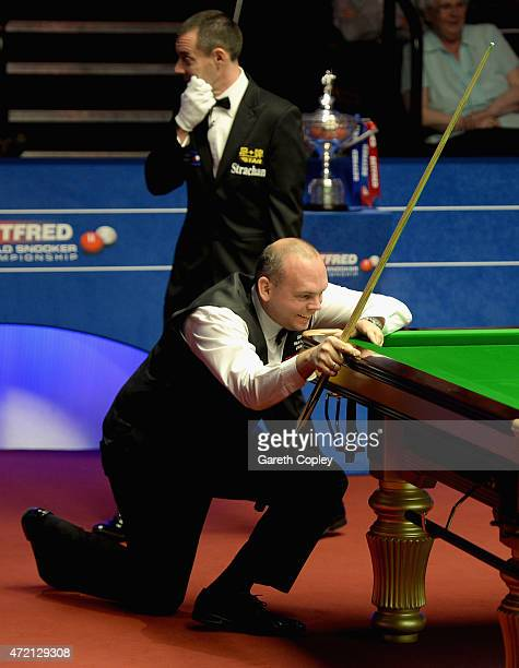 Stuart Bingham reacts after running out of position when set to make a maximum 147 break during the final of the 2015 Betfred World Snooker...