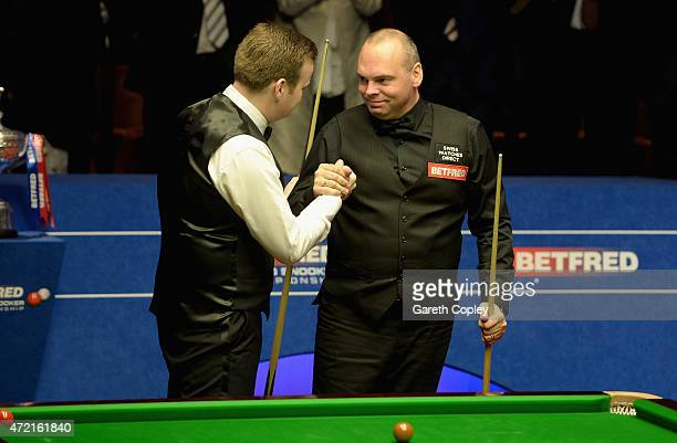 Stuart Bingham shakes with Shaun Murphy after winning the final of the 2015 Betfred World Snooker Championship at Crucible Theatre on May 4 2015 in...