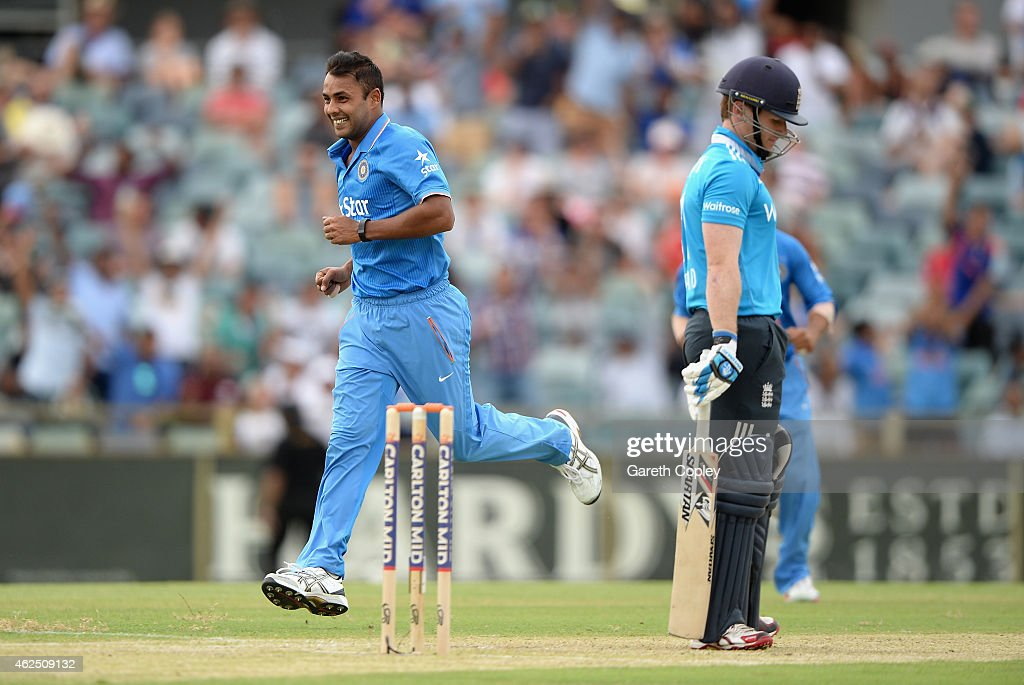 Stuart Binny of India celebrates dismissing England captain Eoin Morgan during the One Day International match between England and India at WACA on January 30, 2015 in Perth, Australia.