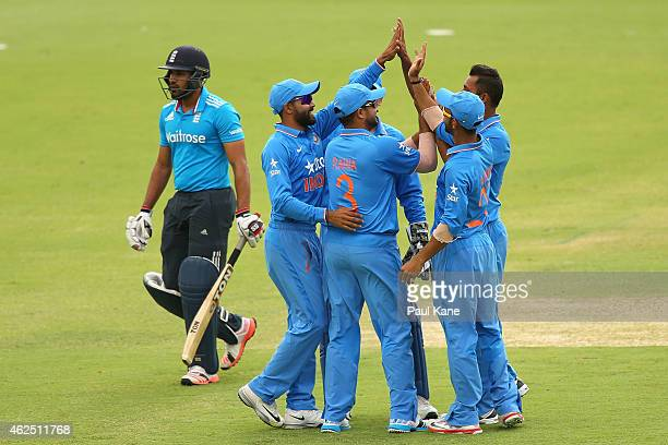 Stuart Binny of India celebrates the dismissal of Ravi Bopara of England with team mates during the One Day International match between England and...