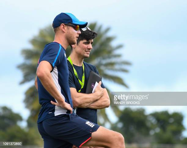 Stuart Broad and Alastair Cook of England chat during a training session one day ahead of the 2nd Test between West Indies and England at Vivian...