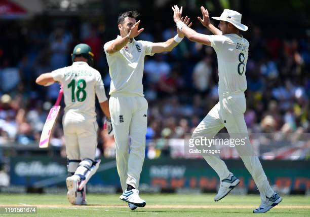 Stuart Broad and James Anderson of England celebrate the wicket of Faf du Plessis of South Africa during day 2 of the 2nd Test match between South...