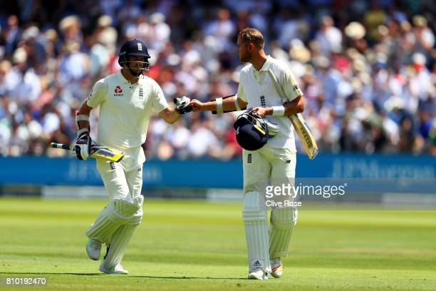 Stuart Broad and James Anderson of England touch gloves at the end of Englands first innings on day two of the 1st Investec Test match between...