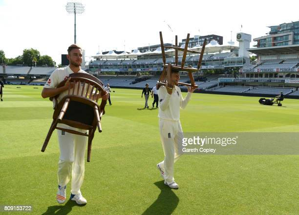Stuart Broad and Joe Root of England carry their chairs back after posing for a team photograph at Lord's Cricket Ground on July 5 2017 in London...
