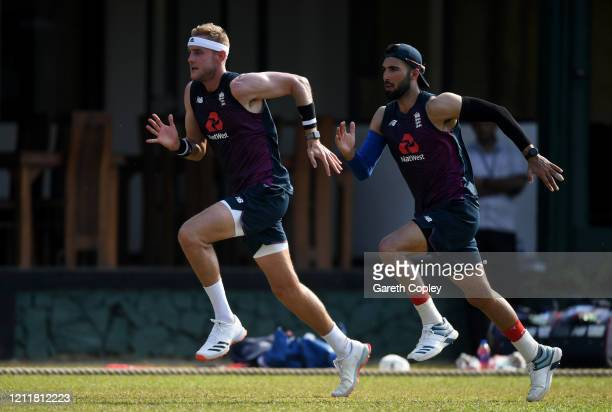 Stuart Broad and Saqib Mahmood of England run during a nets session at the P Sara Oval on March 11 2020 in Colombo Sri Lanka