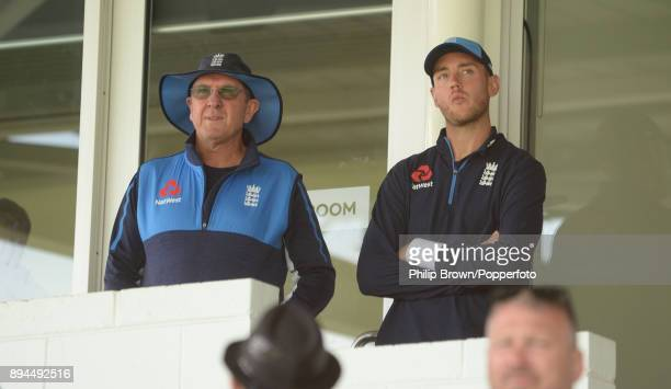 Stuart Broad and Trevor Bayliss of England look on as play is delayed before the fifth day of the third Ashes cricket test match between Australia...