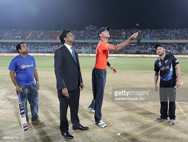 Stuart Broad captain of England tosses the coin with Brendon McCullum captain of New Zealand match referee Javagal Srinath and Pepsi mascot Rayhan...