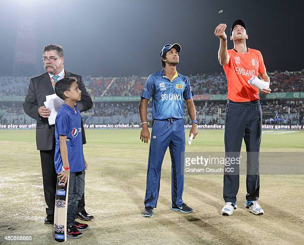 Stuart Broad captain of England tosses the coin with Dinesh Chandimal captain of Sri Lanka, match referee David Boon and Pepsi mascot Adryan ahead of...