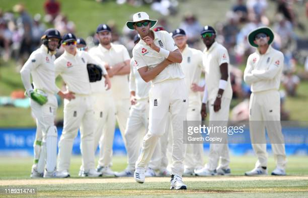 Stuart Broad of England and teammates watch the big screen replay after referring a decision to the 3rd umpire during day two of the first Test match...