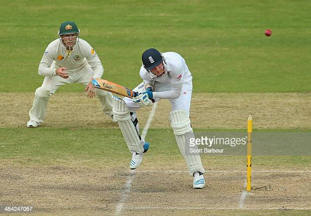 Stuart Broad of England avoids a short ball from Mitchell Johnson of Australia during day four of the Second Ashes Test Match between Australia and...