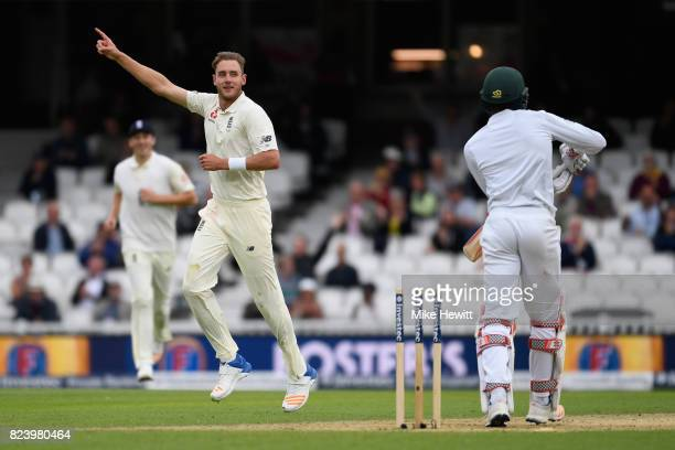 Stuart Broad of England celebrates after bowling Kagiso Rabada of South Africa during Day Two of the 3rd Investec Test match between England and...