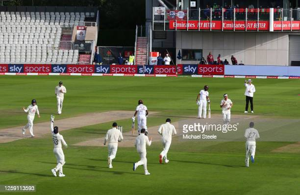 Stuart Broad of England celebrates after taking the wicket of Kemar Roach of West Indies during Day Three of the Ruth Strauss Foundation Test, the...