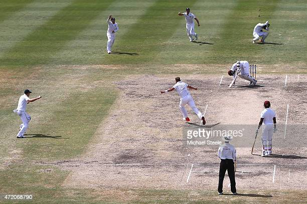 Stuart Broad of England celebrates after taking the wicket of Marlon Samuels of West Indies during day three of the 3rd Test match between West...