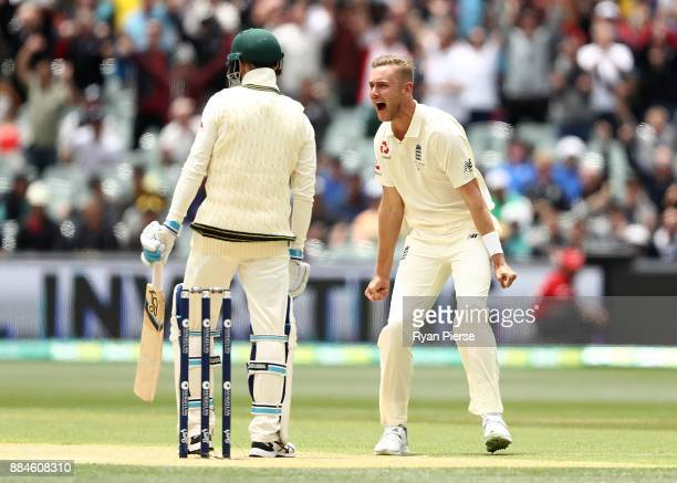 Stuart Broad of England celebrates after taking the wicket of Peter Handscomb of Australia during day two of the Second Test match during the 2017/18...