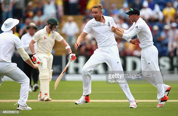 Stuart Broad of England celebrates after taking the wicket of Steve Smith of Australia during day four of the 1st Investec Ashes Test match between...