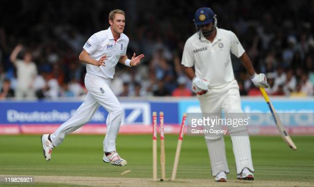 Stuart Broad of England celebrates bowling Praveen Kumar of India during day five of the 1st npower test match between England and India at Lord's...