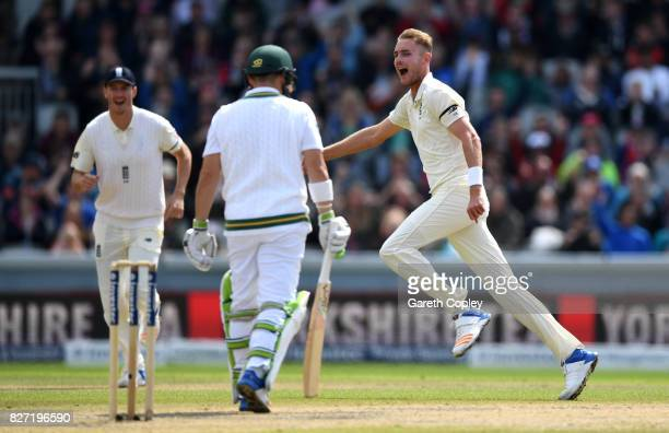 Stuart Broad of England celebrates dismissing Dean Elgar of South Africa during day four of the 4th Investec Test match between England and South...