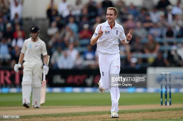 Stuart Broad of England celebrates dismissing Hamish Rutherford of New Zealand during day two of the second Test match between New Zealand and...