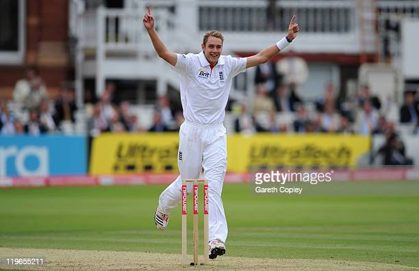 Stuart Broad of England celebrates dismissing Praveen Kumar of Indian during the first npower test match between England v India at Lord's Cricket...