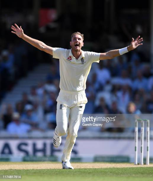 Stuart Broad of England celebrates dismissing Steven Smith of Australia during day four of the 5th Specsavers Ashes Test between England and...
