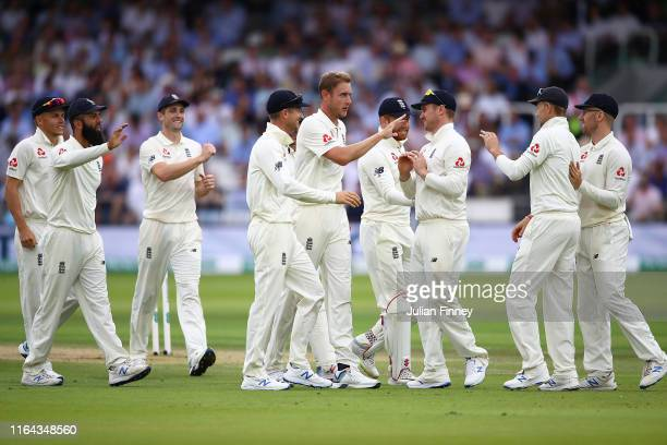 Stuart Broad of England celebrates taking the wicket of Andy McBrine of Ireland during day three of the Specsavers Test Match between England and...