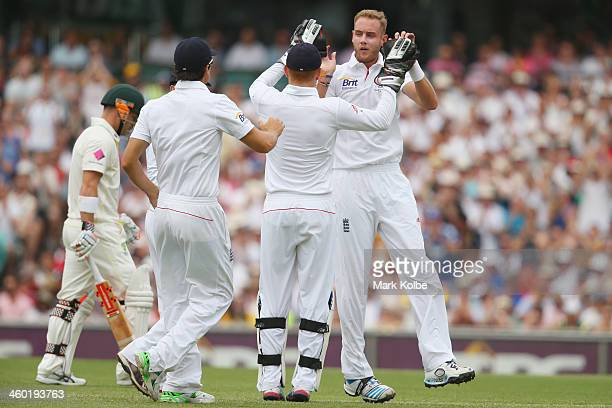 Stuart Broad of England celebrates taking the wicket of David Warner of Australia during day one of the Fifth Ashes Test match between Australia and...