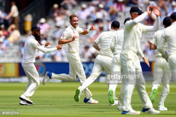 Stuart Broad of England celebrates taking the wicket of Heino Kuhn of South Africa on day two of the 1st Investec Test match between England and...