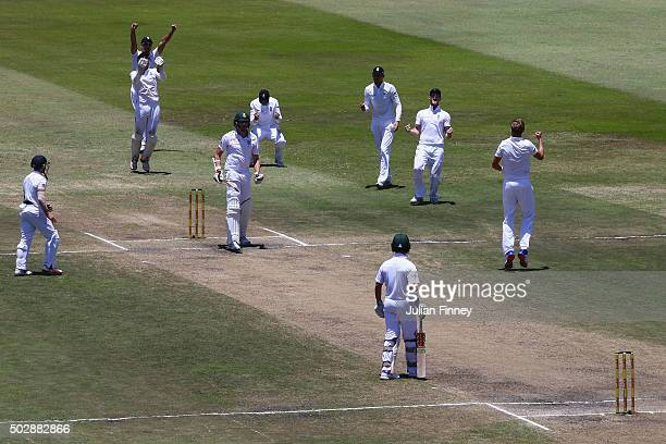 Stuart Broad of England celebrates taking the wicket of Morne Morkel of South Africa lbw to win the match during day five of the 1st Test between...