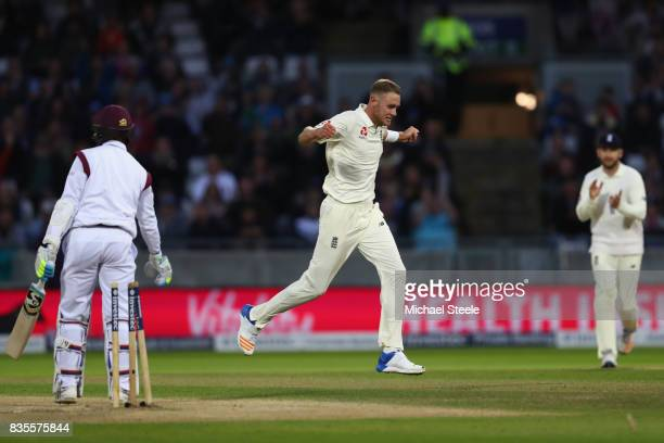 Stuart Broad of England celebrates taking the wicket of Shane Dowrich to become England's second highest wicket taker in Tests during day three of...