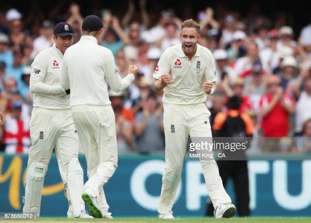 Stuart Broad of England celebrates taking the wicket of Shaun Marsh of Australia during day three of the First Test Match of the 2017/18 Ashes Series...