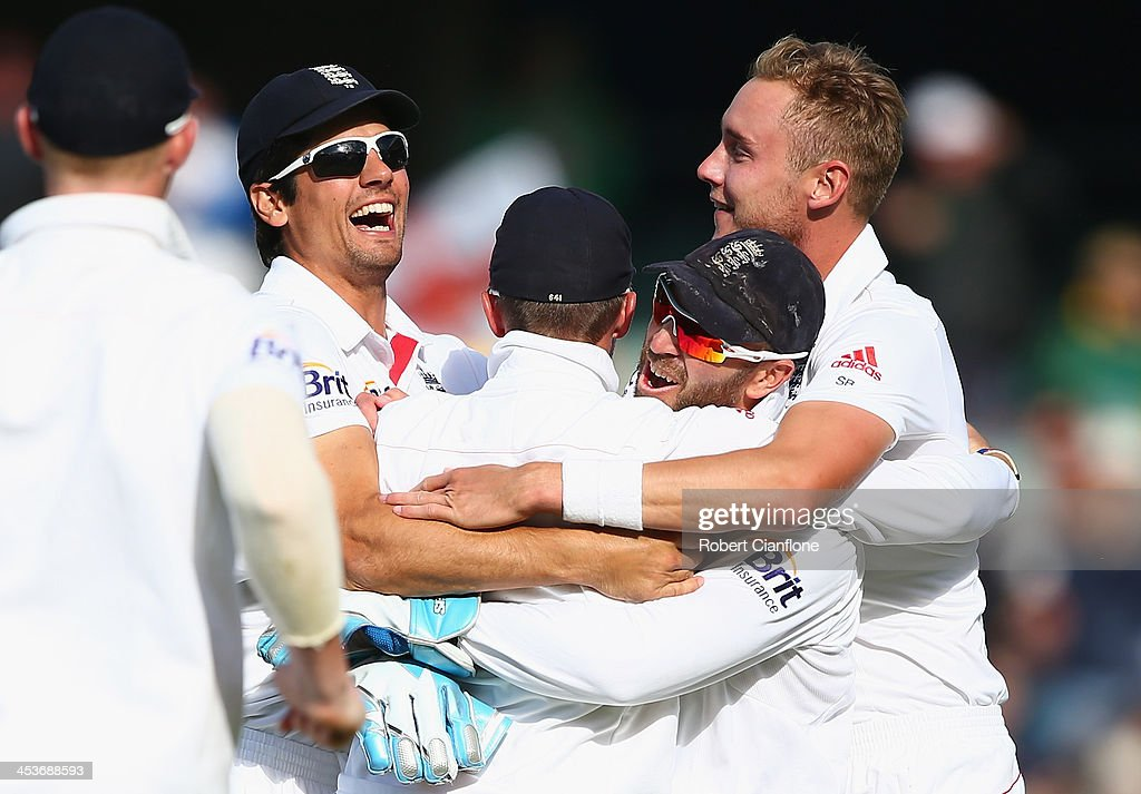 Stuart Broad of England celebrates the wicket of George Bailey of Australia after he was caught by Graeme Swann of England during day one of the Second Ashes Test Match between Australia and England at Adelaide Oval on December 5, 2013 in Adelaide, Australia.