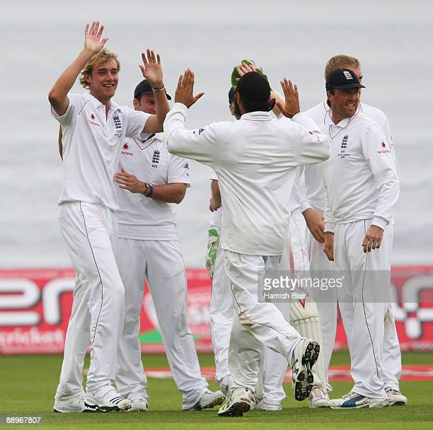 Stuart Broad of England celebrates the wicket of Michael Clarke of Australia with team mates during day three of the npower 1st Ashes Test Match...