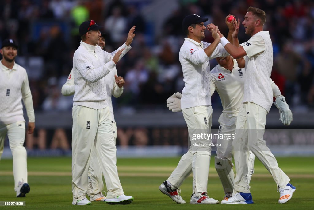 Stuart Broad (R) of England celebrates with Alastair Cook after capturing the wicket of Jason Holder during day three of the 1st Investec Test match between England and West Indies at Edgbaston on August 19, 2017 in Birmingham, England.